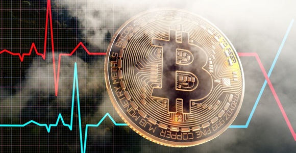 Trading chart showing volatile market movements behind a physical Bitcoin coin